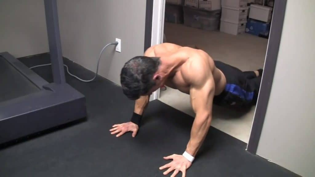 mid back exercise by the doorway